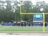 2020-07-25-Graduation-faculty-framed-on-field